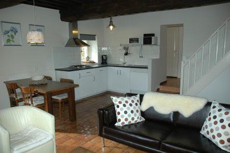 Gezellige woonkamer van gîte Le Menhir